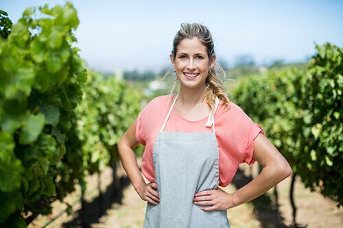 portrait-of-female-farmer-at-vineyard-CY66X5M-1.jpg